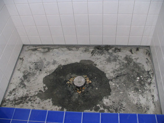 Hot Mop Shower With Open Weep Holes At Drain Protected By Gravel